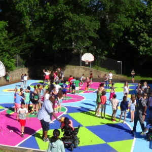 Students playing on repainted basketball court