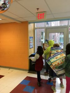 Students hanging recycling posters