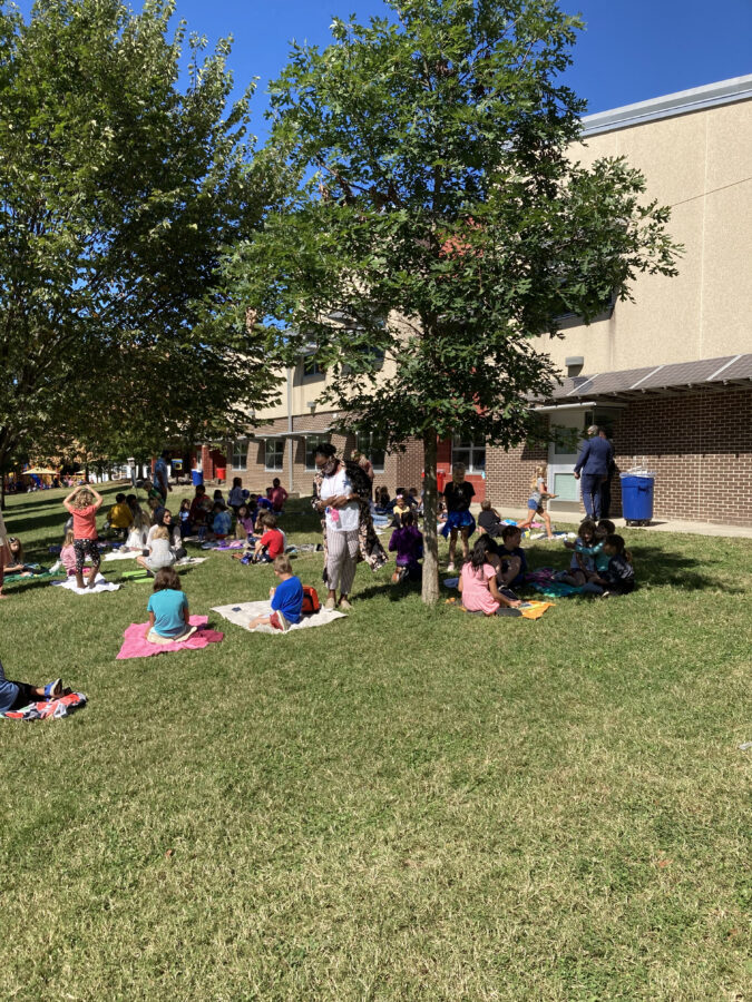 students enjoying lunch outdoors